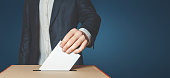 Man Voiter Putting Ballot Into Voting box. Democracy Freedom Concept