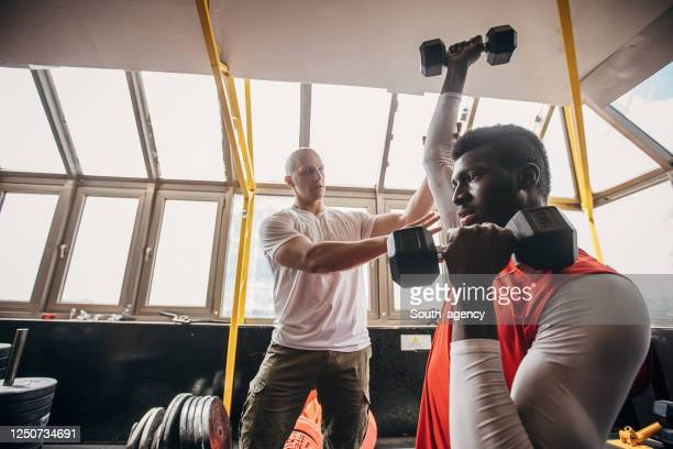 man volleyball player training with personal trainer in the gym - south_agency stock pictures, royalty-free photos & images