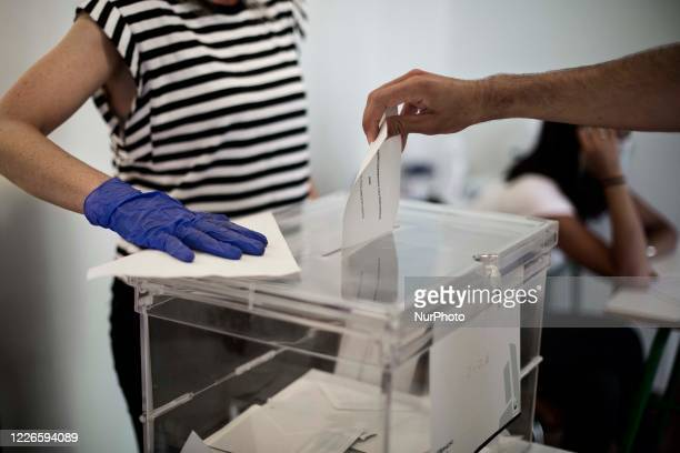 Man votes at an electoral college during election day in the town of Bermeo, in the Basuqe Country region of Spain. Elections in the region of the...