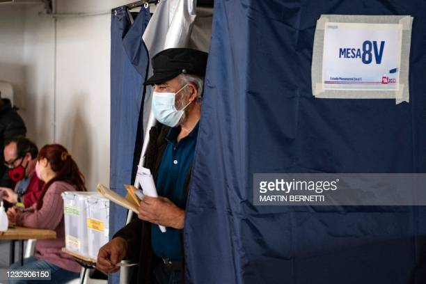 Man votes during elections to choose mayors, councillors and a commission to rewrite the constitution in Santiago, on March 15, 2021.