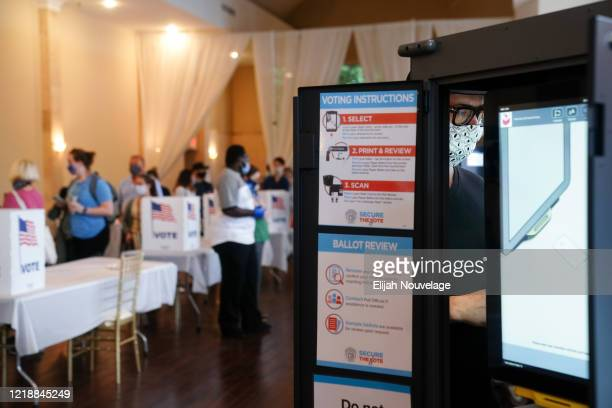 A man votes in Georgia's Primary Election on June 9 2020 in Atlanta Georgia Voters in Georgia West Virginia South Carolina North Dakota and Nevada...