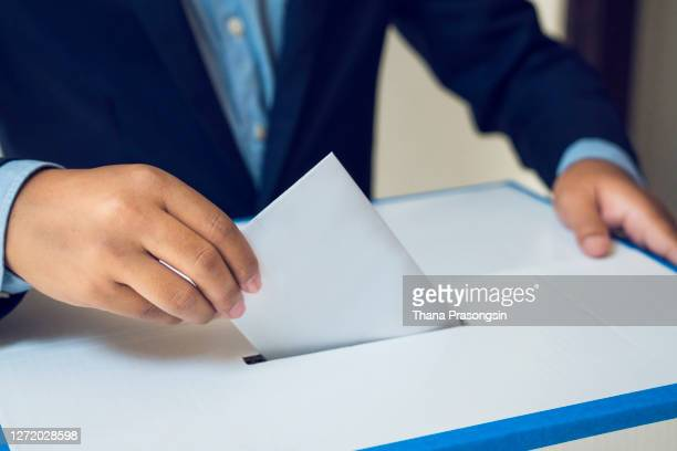 man voting in election - presidential election stock pictures, royalty-free photos & images
