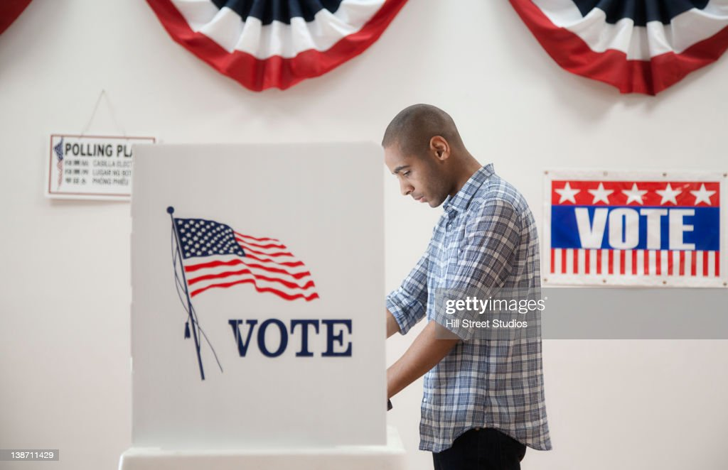 Man voting in polling place : Stock Photo