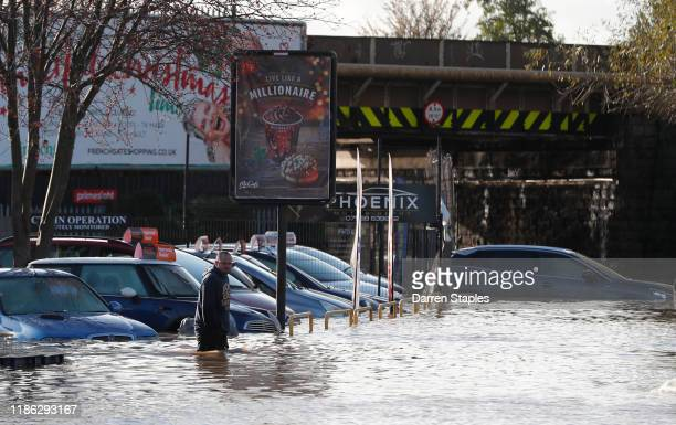 A man wades through flood waters after the River Don burst its banks on November 08 2019 in Rotherham United Kingdom Parts of northern England...