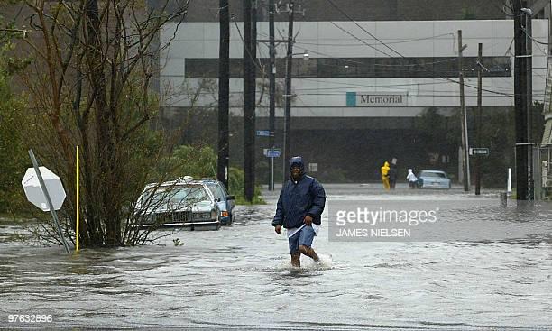 A man wades through high water 29 August 2005 in New Orleans after Hurricane Katrina made landfall near the Louisiana metroplis Hurricane Katrina...