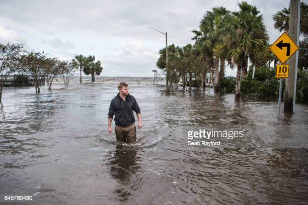 A man wades through storm surge flood waters from Hurricane Irma along the St Johns River in the Five Points neighborhood Sept 11 2017 in...