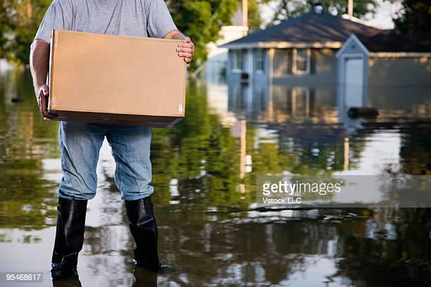 Man wading after flood