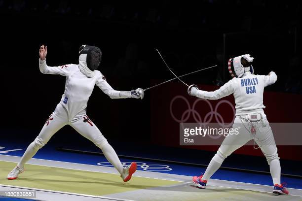 Man Wai Vivian Kong of Team Hong Kong, left, competes against Kelley Hurley of Team United States in Women's Épée Team Classifications on day four of...