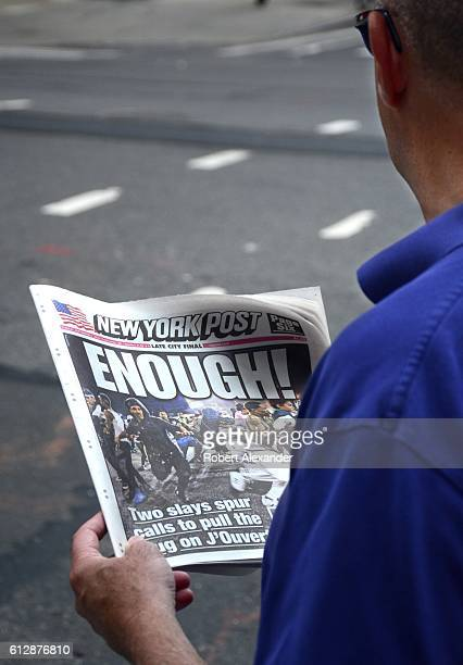 September 6, 2016: A man waiting at a New York City intersection reads a copy of the New York Post. The headline is an editorial response to two...
