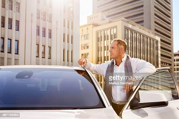Man waiting at his car