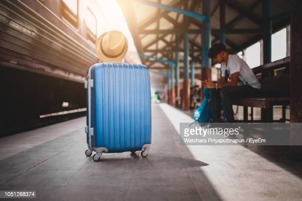 man waiting at railroad station platform - blue hat stock pictures, royalty-free photos & images