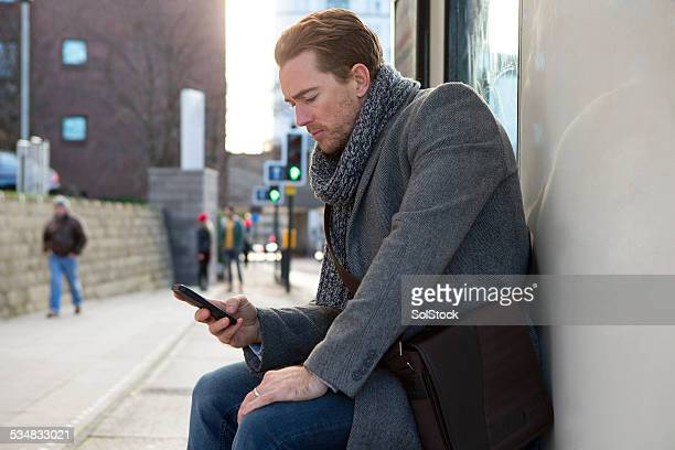 Man Waiting at the Bus Stop