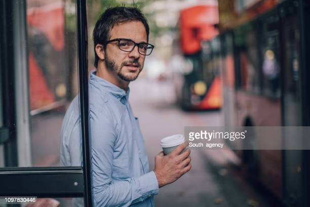 man waiting for a bus - south_agency stock pictures, royalty-free photos & images