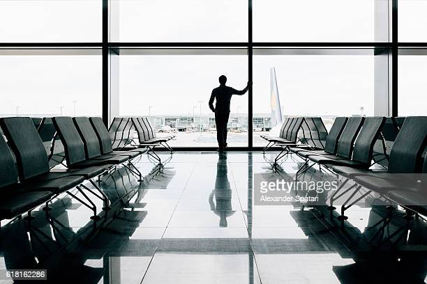 Man waiting for a flight in an airport departure area
