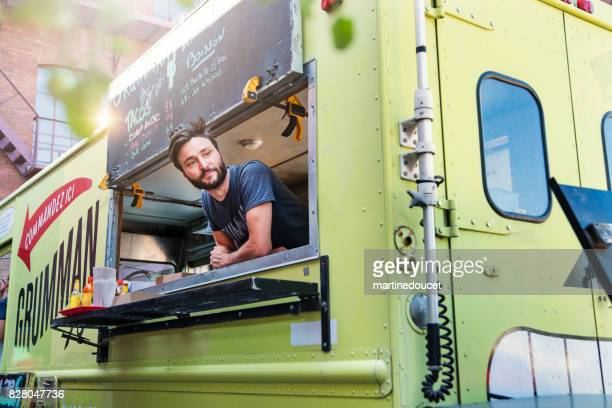 "man waiting for clients in food truck in city streets. - ""martine doucet"" or martinedoucet stock pictures, royalty-free photos & images"