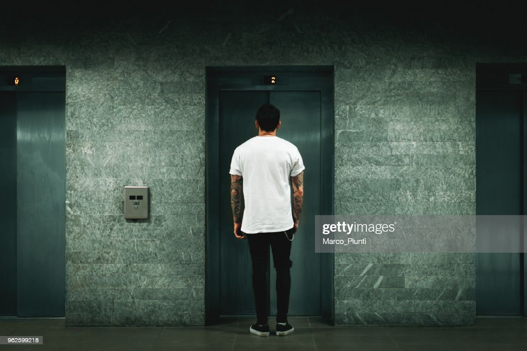 Man waiting for elevator : Stock Photo