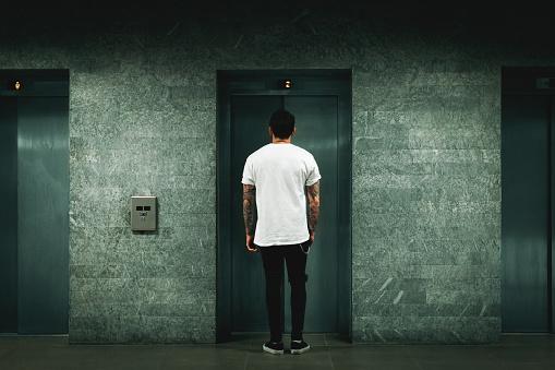 Man waiting for elevator - gettyimageskorea