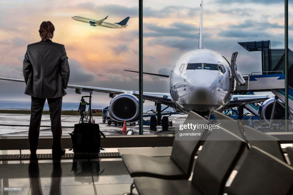 Man Waiting for Flight in Airport Lounge : Stock Photo