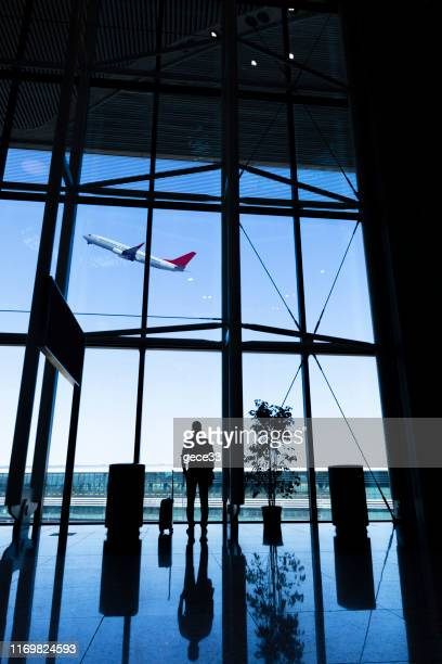 man waiting for flight in airport - vertical stock pictures, royalty-free photos & images