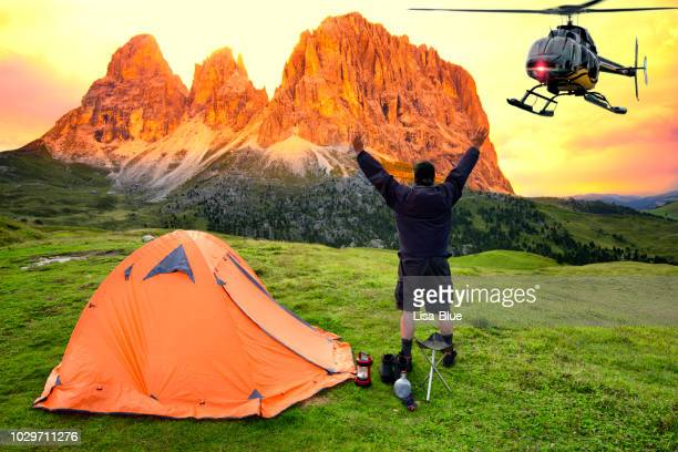 man waiting for helicopter rescue in mountain - rescue worker stock pictures, royalty-free photos & images