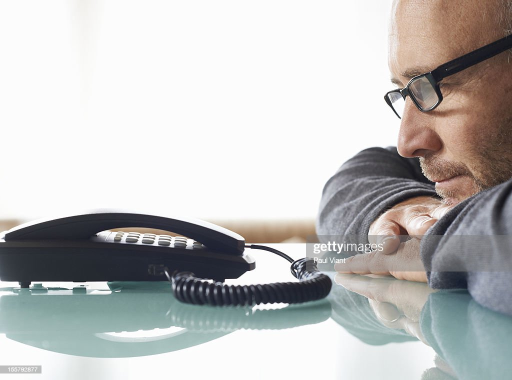 man waiting for phonecall : Stock Photo