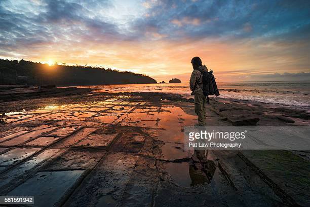 Man waiting for Sunrise at Tessellated Pavement