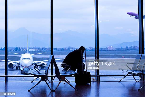Man Waiting for the Flight in Airport Lobby