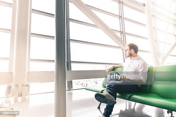 man waiting his flight