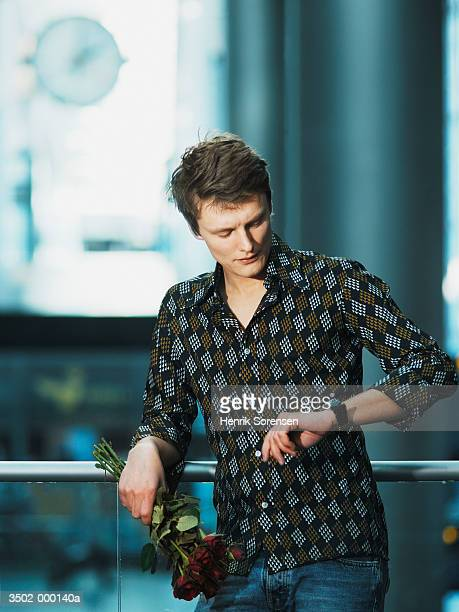 man waiting in airport - impatience flowers stock pictures, royalty-free photos & images