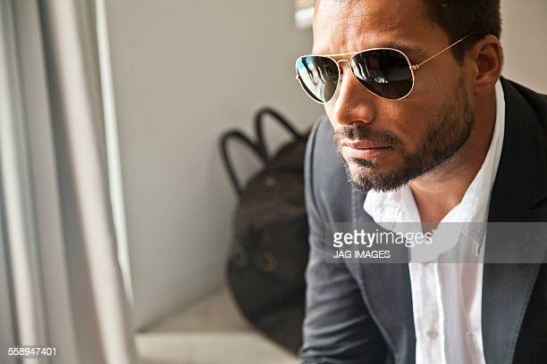 Man waiting indoors