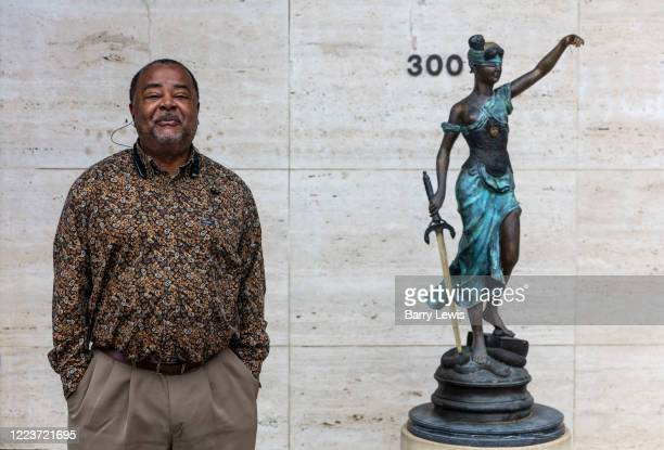 Man waiting outside lawyers office on 5th March 2020 in downtown Dothan, 'The Peanut Capital of the World', Alabama, United States of America. Lady...