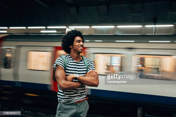 man waiting the train at the station - carriage stock pictures, royalty-free photos & images