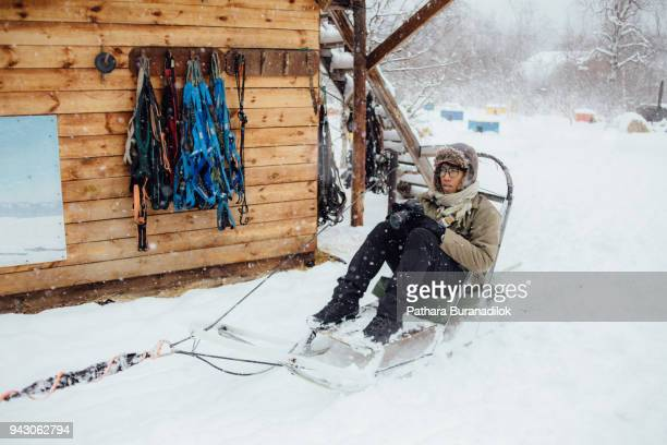 A man waiting to start dog sled