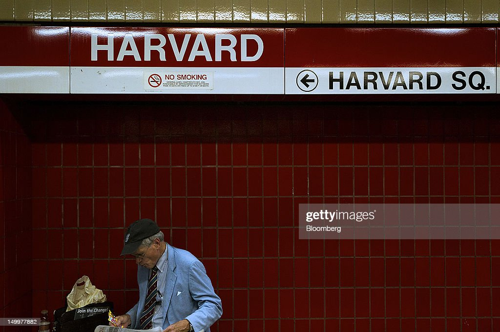 A man waits for a subway at Harvard station in Cambridge, Massachusetts, U.S., on Monday, Aug. 6, 2012. Harvard University, an American private Ivy League research university established in 1636, is the oldest institution of higher learning in the United States and the first corporation chartered in the country. Photographer: Brent Lewin/Bloomberg via Getty Images