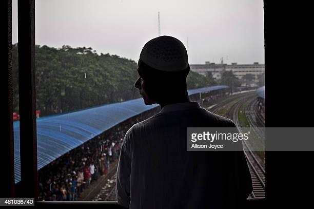 A man waits for a train as Bangladeshi Muslims head home to their respective villages ahead of Eid AlFitr July 17 2015 in Dhaka Bangladesh The Eid...