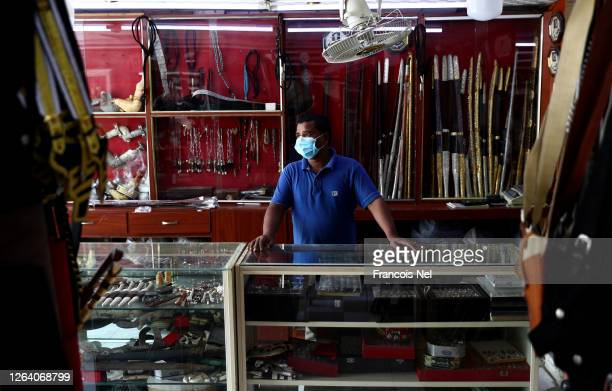 A man waits for customer at his shop on August 05 2020 in Ras Al KhaimahUnited Arab Emirates The Coronavirus pandemic has spread to many countries...