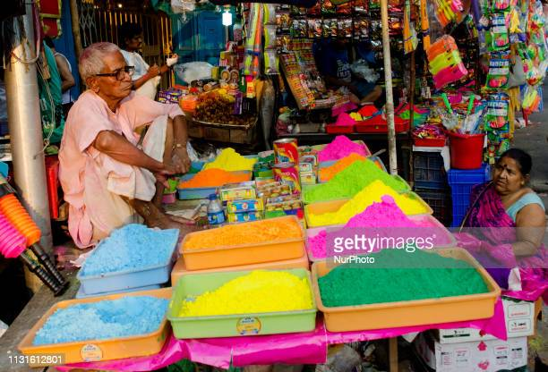 A man waits for customers as he sells colourful powder and other items for Holi in Kolkata India on 19 March 2019 The Hindu Festival of Holi also...