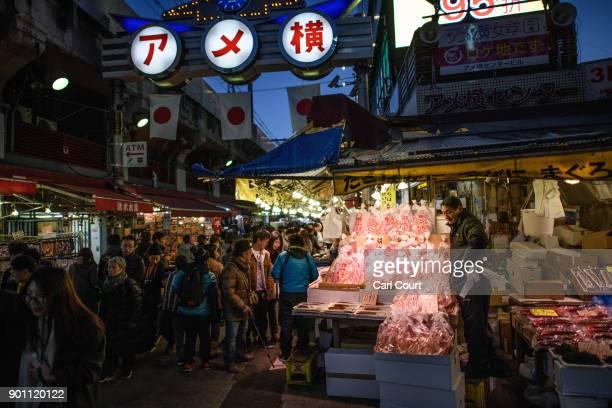 A man waits for customers at a seafood stall in Ameya Yokocho market on January 4 2018 in Tokyo Japan Ameya Yokocho claimed to be Tokyo's last...