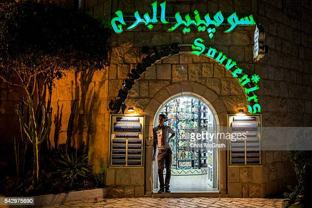 A man waits for customers at a souvenir store on June 24 2016 in Sousse Tunisia Before the 2011 revolution tourism in Tunisia accounted for...