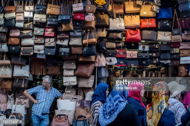 A man waits for customers at his hanfbag shop on August 16 2018 in Istanbul Turkey In an attempt to reassure investors Turkey's Finance minister...
