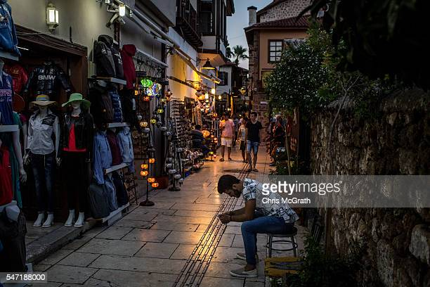 A man waits for customers in the Old Town tourist district on July 13 2016 in Antalya Turkey Russian President Vladimir Putin last month officially...