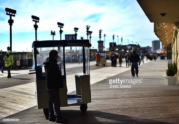 A man waits for passengers to ride his 'push taxi' along the boardwalk in Atlantic City New Jersey on November 8 2014 For decades Atlantic City was a...