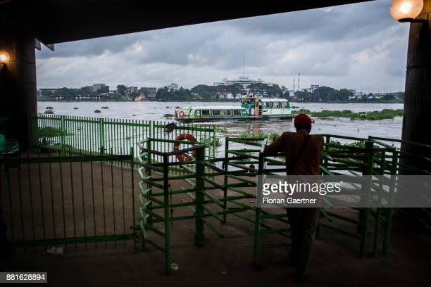 A man waits for the ferry at the Ebrie Lagoon on November 28 2017 in Abidjan Ivory Coast