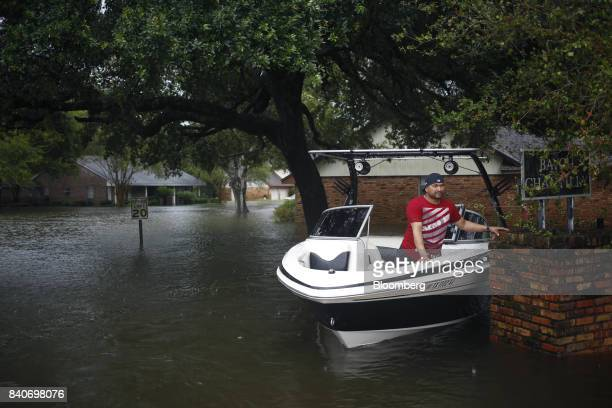 A man waits in a motorboat while making rescues in floodwaters from Hurricane Harvey in Dickinson Texas US on Tuesday Aug 29 2017 Estimates for...