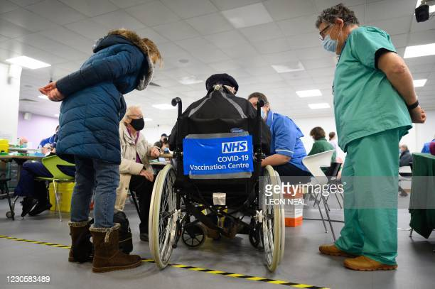 Man waits in a wheelchair for his vaccination coronavirus Covid-19 vaccination at the NHS vaccination centre in Robertson House in Stevenage, north...