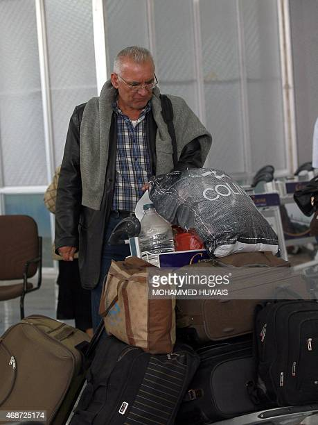 A man waits in the departure lounge at Sanaa International Airport on April 6 2015 as hundreds of foreigners are evacuated from conflicthit Yemen On...