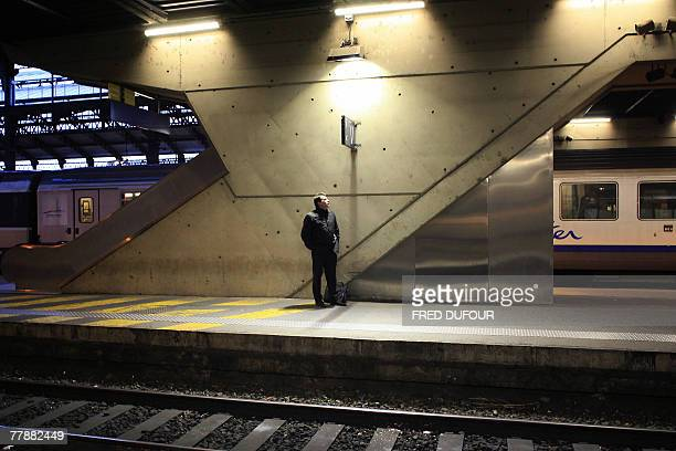 A man waits on a railway platform 13 November 2007 at the Perrache' train station of Lyon France faces several 'hellish' days as railway and metro...