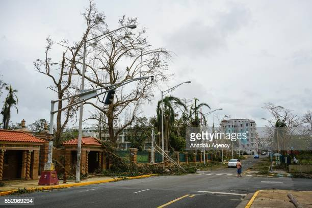 A man waits on a street at the University of Puerto Rico Rio Piedras campus after Hurricane Maria at Ponce de Leon Avenue in San Juan Puerto Rico on...