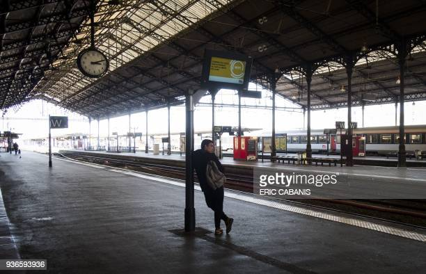 TOPSHOT A man waits on a track of Matabiau train station in Toulouse on March 22 2018 during a strike by railway workers Seven unions representing...