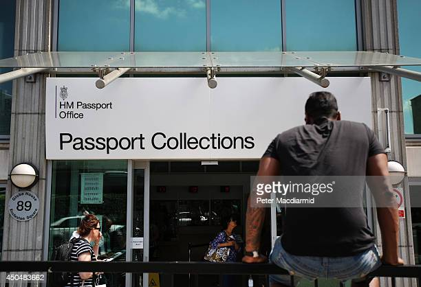 A man waits outside the passport office collections office on June 12 2014 in London England Home Secretary Theresa May has announced extra measures...